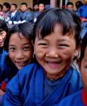 Smiling Bhutanese schoolchildren. Source: commons.wikipedia.org